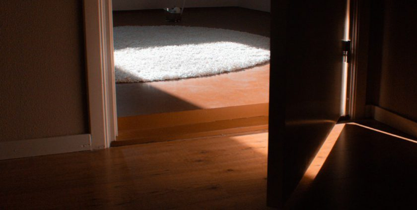 A glimpse into a small room with wooden flooring